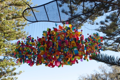Big sculpture made of little kids toys. Child's play really.